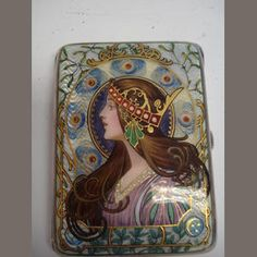 An Art Nouveau enamel and silver cigarette case. No makers mark, Birmingham import 1902 The hinged cover enamelled after Alphonse Mucha, with a girl with a crown bordered by mistletoe | JV