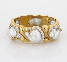 A cultured pearl and diamond bangle
