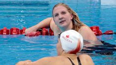 Swimmer Rebecca Adlington discovers she has become Great Britain's second medallist of the day, with a bronze in the 400m freestyle