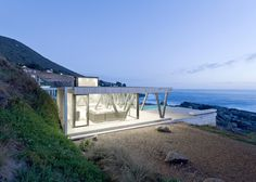 Casa Rambla by LAND Arquitectos faces out over the Pacific Ocean.