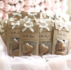Delicious Chocolate Hearts Personalised Wedding Favours with cute Kraft card wrappers, party favors decorated with gold glitter. Minimum order is 15 pieces. (or a pre-made one as a sample) Each bag contains 2 chocolate hearts with edible gold glitter. ##Please give us the