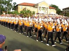 LSU Band marches down hill to Tiger Stadium Love the part at about 1:28 where the horns start!!