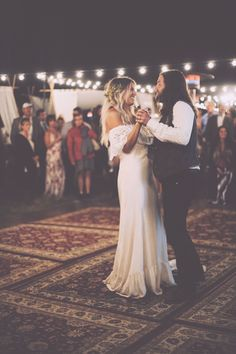 The newlyweds cutting a rug — on a rug. #refinery29 http://www.refinery29.com/brit-castanos-wedding-pictures#slide-13