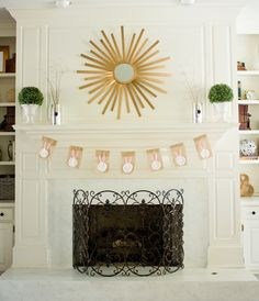 Hang a bunny banner in front of your fireplace for Easter decor!  Photo by Savvy Apron