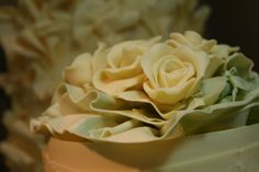 #chocolateroses nestled amongst lemon marbled chocolate fans for a #weddingcake top tier.....