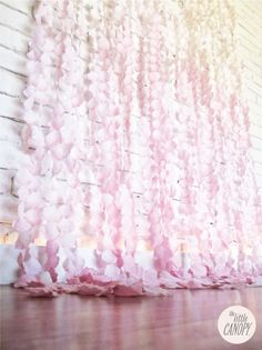 Flower Petal Curtain Backdrop.  Would be so pretty hanging at our venue for the ceremony!