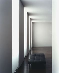 Wall openings creating a rhythm of light and shadow inside the Fabien Baron Apartment in NYC by Deborah Berke & Partners