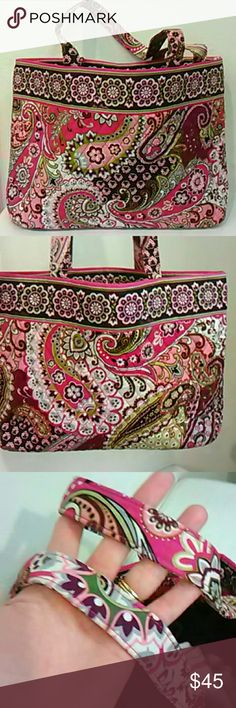 Vera Bradley Paisley East West Tote EUC This is a lovely medium sized tote in the classic Very Berry Paisley print, in shades of pink and purple.  I this this is the East West tote, wider than it is high.  Invisible magnetic closure and three slip pockets inside.  I bought this from a collector, and it is so clean and pristine that I think it is new and unused.  As you can see, edges and corners and straps are perfect.  Gorgeous! Vera Bradley Bags Totes