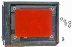 Elizabeth Graves develops another impermanent, non-damaging way to hold thin metal plates in a conventional large format film holder.