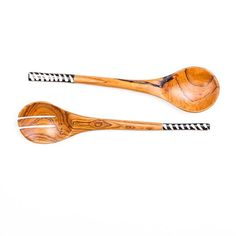 Hand carved African Olive Wood Salad Servers with Bone Decoration in black and white stripe design. Made out of one piece of wood, the oval shaped ladle is carefully carved into thin handles. A stylish accessory to any salad meal. ----- About the brand Love'edu: Lov'edu Living was founded by Ibiza raised Anna Boettcher in 2013 in London. Today, Lov'edu is both a physical and an online ethical store that offers unique interior decoration, accessories, jewellery and lifestyle products. All…
