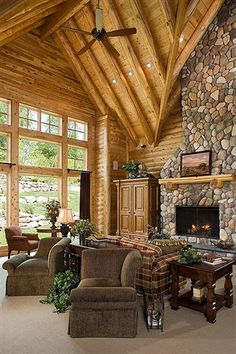 Exposed wooden beams and rock fireplace- Love
