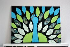 DIY peacock canvas with scrapbook paper