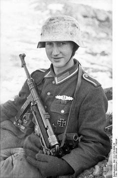 A young German soldier with an MP40 in the Russian winter snow. *Note that he has been awarded the Iron Cross (1st Class), a Close Combat clasp, and the Eastern Front medal. (January-February 1944).