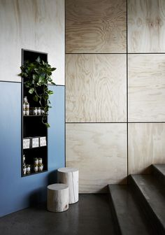 wall in lobby could be clad with limed oak veneer plywood and stainless steel division channels between