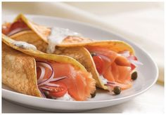Wrap smoked salmon, ricotta, capers, and red onion in a thin crepe. Delicious!