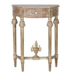 This exquisitely carved small French limed console table is a standout from any angle.