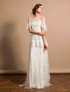 Delphine Manivet, price upon request | 52 Wedding Dresses That Aren't Strapless---Too dainty for me but I like it.