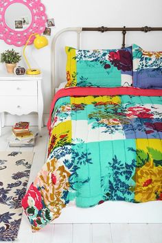 Floral quilt. I love the bright colors mixed with the vintage feeling flowers. Would be perfect for J.