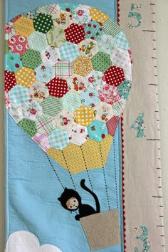 hexagon pieced hot air balloon fabric growth chart via Etsy