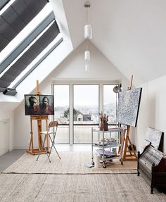 Art Studio in the backyard with high pointed ceilings, bright white walls, lots of open windows for lights, greenery outside, very open and light.