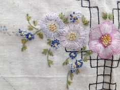 Yesteryear Embroideries: Un-embroidered linens, lying underneath and in piles of vintage embroidered linens,