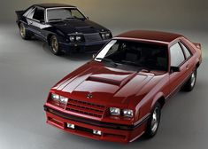 Ford promotional photo of a Medium Red 1982 Mustang GT with a cool black GT in the background. Black Mustang, Fox Body Mustang, Mustang Cobra, Ford Mustang Coupe, Ford Mustang Shelby, Car Ford, Moto Design, Chevrolet Malibu, Pony Car