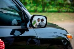 couple in car mirror