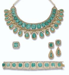 PROPERTY OF A ROYAL HOUSE: AN EMERALD AND DIAMOND SUITE Comprising a necklace mounted with seventeen graduated rectangular-shaped emeralds between brilliant-cut diamond sides, suspending pear-shaped emerald drops and pavé-set diamond triangular panels to a circular-link backchain, bracelet, ear pendants and ring en suite.
