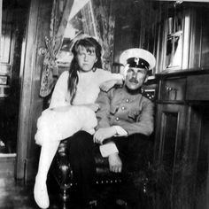 Grand Duchess Anastasia with officer l This officer interests me. He seems to have been very close to the family--almost like family.