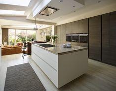 Snug Kitchens Newbury. Pronorm YLine kitchen with super matt crystal white base units, rift oak dark décor tall and mid units, Caesarstone shitake worktop and a solid oiled walnut breakfast bar.
