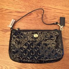 NWT Authentic Coach purse Brand new authentic coach purse, shiny black. Tag is still on! Coach Bags Mini Bags