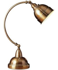 Metal desk lamp in satin brass with a curving silhouette. Product: Desk lamp Construction Material: Metal Color: Satin brass Features: Traditional style On/off switch Accommodates: 40 Watt Edison base bulb - not included Dimensions: H x W Lamp Light, Adjustable Desk, Adjustable Desk Lamps, Adjustable Lamps, Modern Style Lights, Hanging Lamp, Metal Desk Lamps, Desk Lamp, Brass Desk Lamp