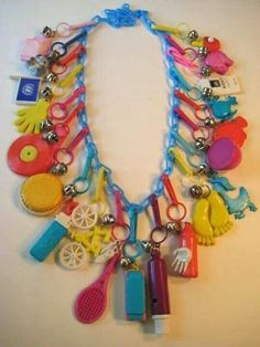 Vintage Toys Plastic Charm Necklace - If you were a girl in the you probably had some plastic charms for a bracelet or necklace. They were colorful, fun, and cheap! These little bell charms have only grown in their awesomeness! 90s Childhood, My Childhood Memories, Best Memories, Toy History, British History, History Facts, Strange History, Kitsch, School Memories
