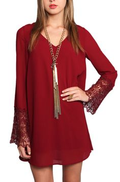 We love this garnet dress with bell sleeves. Love the detailed lace. Wld definitely change the necklace...