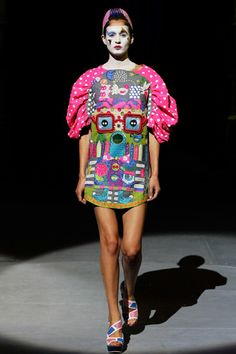 Manish Arora's Fish Fry. Designs of my dreams.    This is from his SS-2009 collection, which also features the gorgeous, wicked merry-go-round skirt dress Katy Perry wore at the MTV Awards a coupla years ago. - http://www.glamourmagazine.co.uk/dos-and-donts/style-and-fashion/2008/11/10/katy-perry-wears-manish-arora-at-mtv-awards