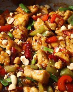 This Kung Pao Tofu is a blend of tofu, bell peppers, chilies, green onions and peanuts, all in a savory and spicy sauce. A vegan remake of the take out classic that's even better than the restaurant version! To make a plant-based Kung Pao recipe that's completely vegan, we're using tofu instead of chicken. This Kung Pao Tofu recipe still includes the classic sauce that we love so much! Instead of picking up the phone to call for take out, whip up this tasty recipe at home in just 40 minutes!