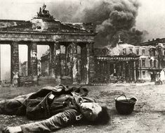 1945 - Berlin, Germany: A dead German soldier by Brandenburg Gate.