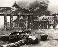 1945 - Berlin, Germany: A dead German soldier by Brandenburg Gate.