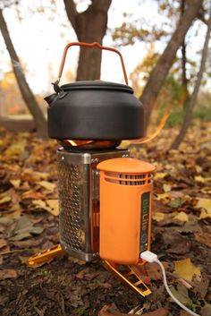 BioLite CampStove: As small as a reusable water bottle and it recharges electronics to boot. All with sticks and twigs. :)