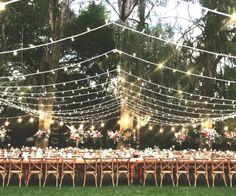 wedding canopy Outdoor wedding reception featuring a combination of a fairy light canopy, fairy. Outdoor Fairy Lights, Fairy Lights Wedding, Outdoor Chandelier, Outdoor Lighting, Chandeliers, Garden Event Lighting, Lighting Ideas, Wedding Lighting, Outdoor Night Wedding