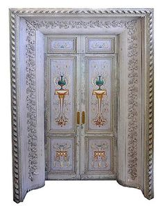 Pair of very fine, rare, late Louis XVI polychrome decorated doors within a door surround