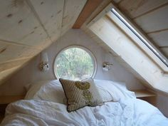 Vinas Updated 140 Sq. Ft. Tiny Home on Wheels (Part 2) Photo ~ Love the round window and the other one too!  Lots of light.