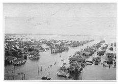 Photograph of an aerial view of a flooded neighborhood near downtown Port Arthur, Texas.  Flooding resulted from a hurricane, and spans the entire photograph.