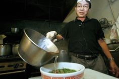 Pho Tau Bay restaurant owner Henry Le adds the broth to complete the pho. Hawaii news photo - The Honolulu Advertiser