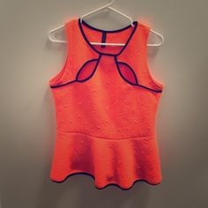 Neon Orange Peplum Top NWOT. Neon orange textured top trimmed in black with key hole detailing. Size juniors XL. Fits a misses medium so I am listing it as such. Awesome stretch, pair with black bottoms and go!  NO TRADES Ma Cherie Tops Blouses