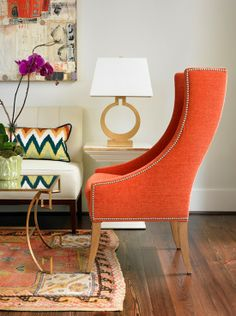// living room accent?  Orange //  orange studded modern wingback with brass coffee table