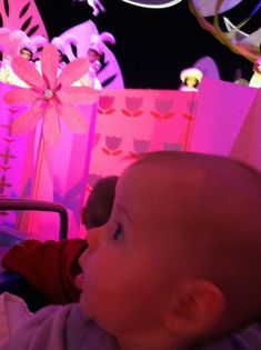 Disney Baby Tip #6: Help them not be overwhelmed. Even very young babies can appreciate the sounds, colors and excitement at Disney.  However, it can also be overwhelming.  Be aware that even if you are sitting down, out of the way, with your baby covered, there is probably a lot of unfamiliar noise and music around.  As adults, we can tune out the sounds, but that is harder for an infant.  If your baby is easily over stimulated, this is where the Baby Care Centers come in handy.