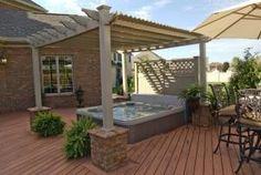 raised wood floor and pergola off of garage for hot tub