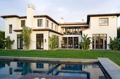 Copper roof & dark gutters /// Spanish Revival home gets an exquisite facelift