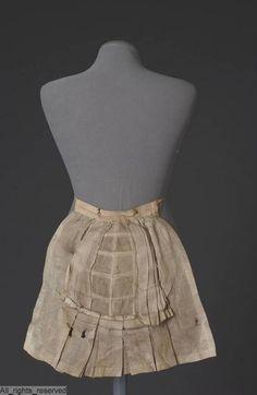 Tournure  Identifier AF208 Creation date 1880/1890 Material cotton, baleen Object Type bustle Local type tournure ModeMuseum Provincie Antwerpen